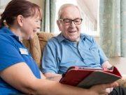 NorseCare working using iPad with a resident