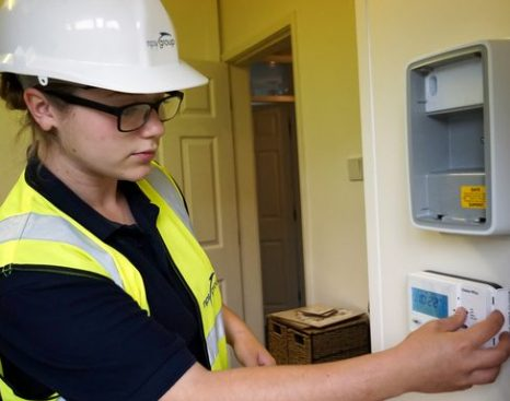 Young female performing property checks