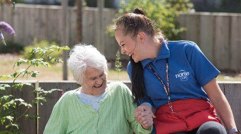 NorseCare employee laughing with an elderly resident in one of our Norfolk based residential homes